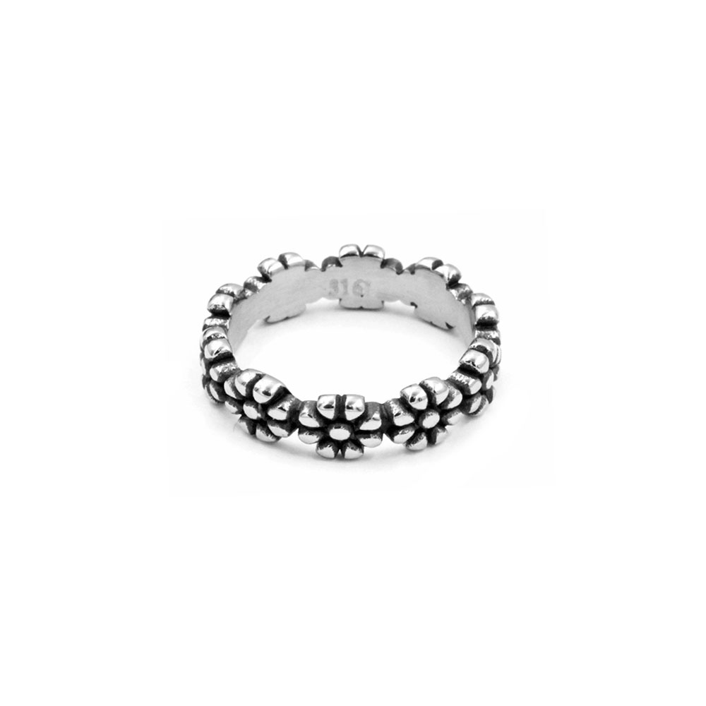Solid ring with intertwined flowers